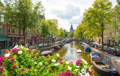 Canal in old city at daytime in Amsterdam.