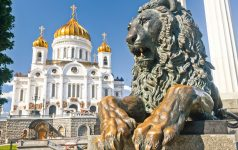 Manument lion with Christ the Savior Cathedral in Moscow