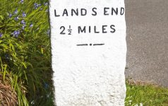 Milestone on roadside pointing to Land's End Cornwall England UK