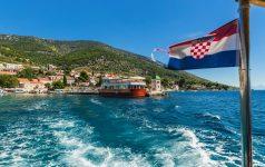 Croatian Bol city on Brac island view from sea .