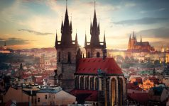 Ancient cathedrals of Prague at sunrise. View from above